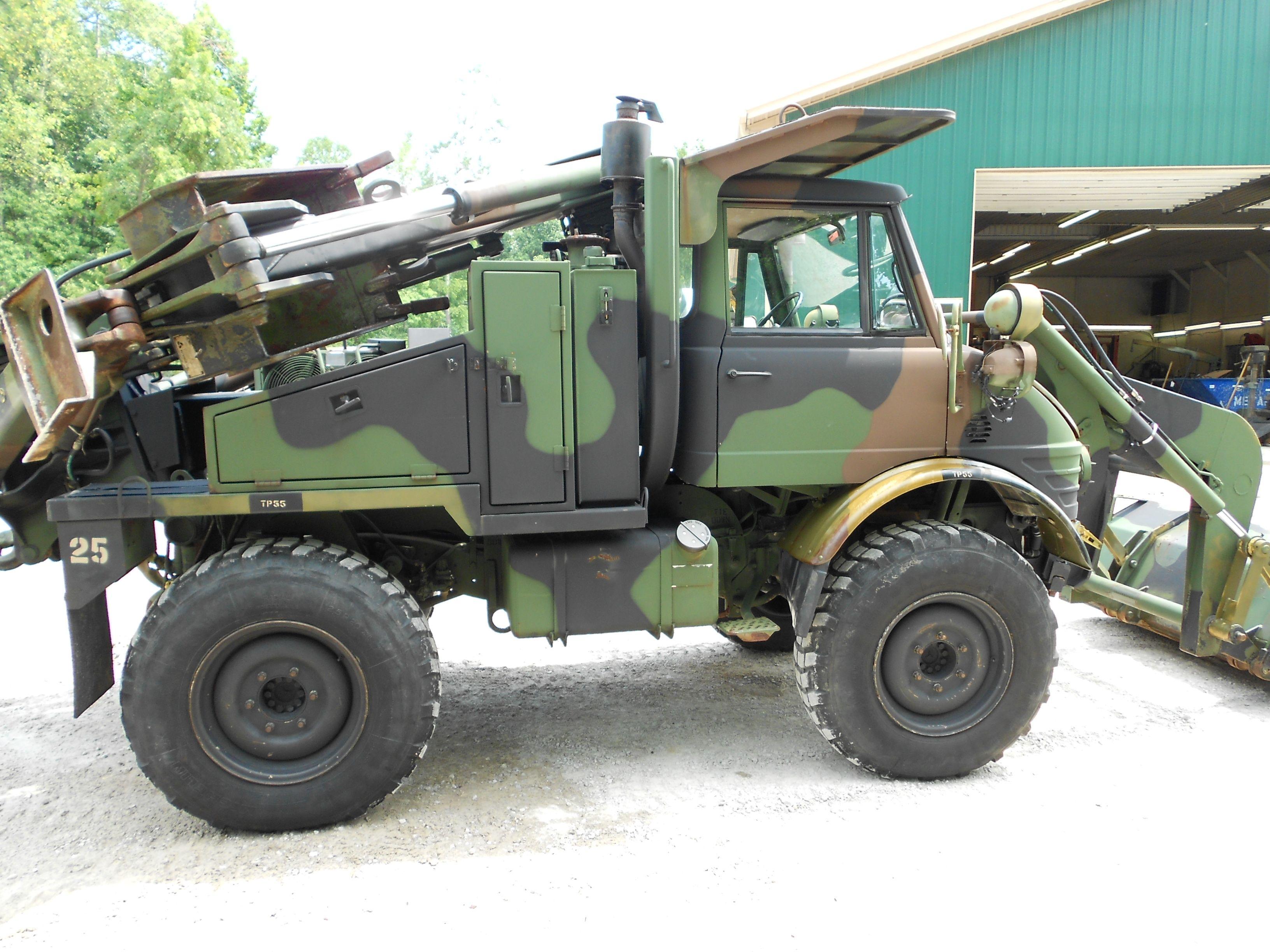 Military unimog loader and backhoe