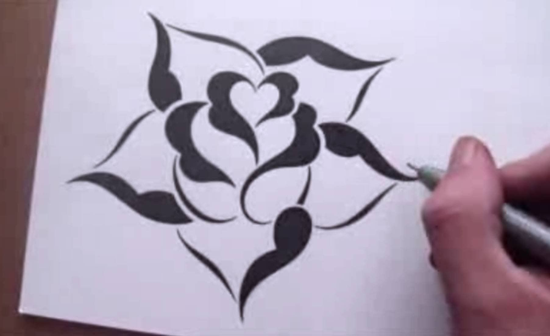 Drawing A Rose In A Simple Stencil Design Style Rose Drawing Simple Rose Drawing Easy Heart Drawings