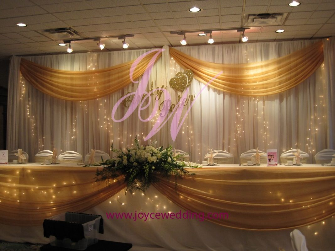 Twinkle lights and gold sash backdrop decoration for Backdrops decoration