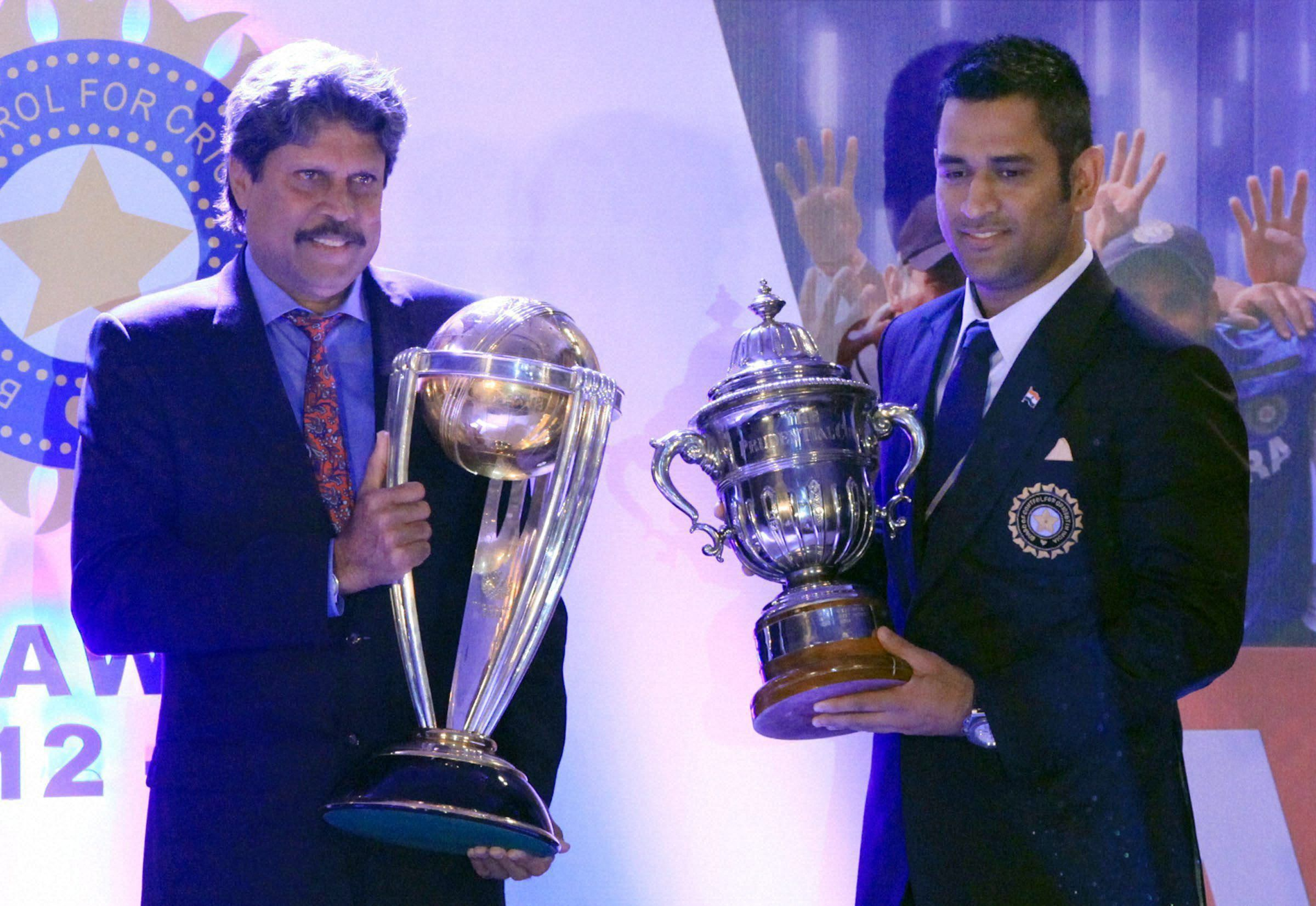 The Two Eras Kapil Dev Holding The 2011 World Cup Trophy And Ms Dhoni The One India Lifted In 1983 At The Bcci Awards Func Cricket In India Kapil Dev Cricket