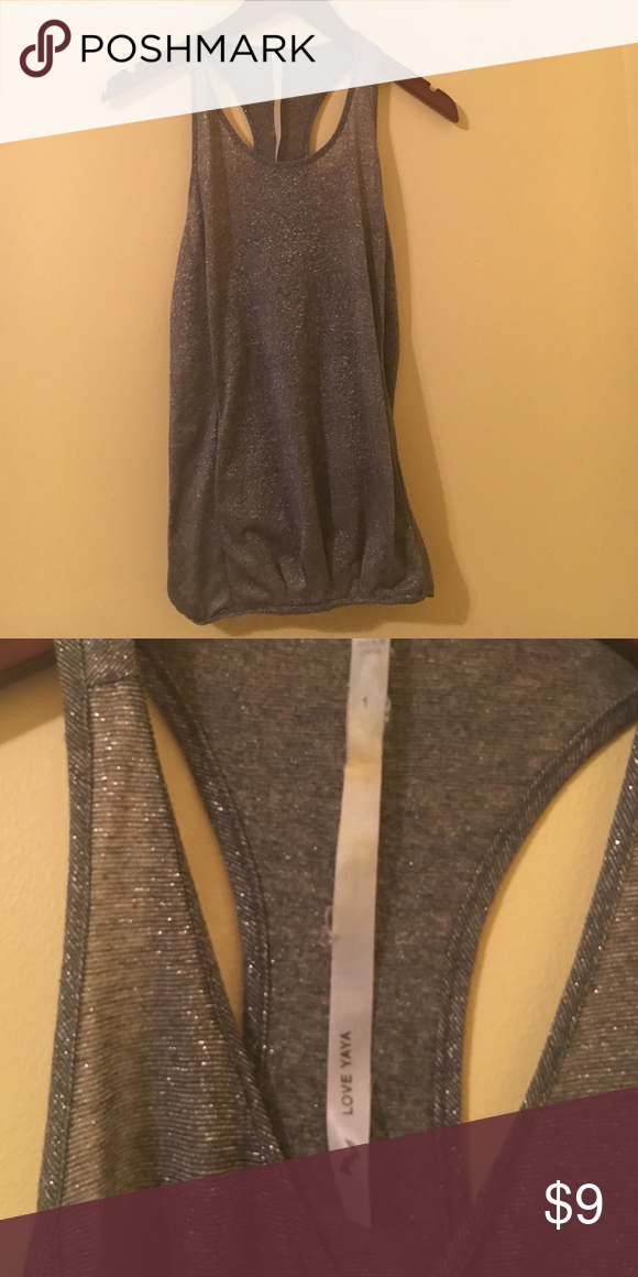 Silvery grey tank top from Love Yaya Silver grey tank top from Love Yaya. Cinched at the bottom. Has been worn but still in great condition! Fits size small or medium. Cute racer back tank! 💙💛 Feel free to make an offer, no price is set in stone. Save money on bundles! 💛💙 Tops Tank Tops