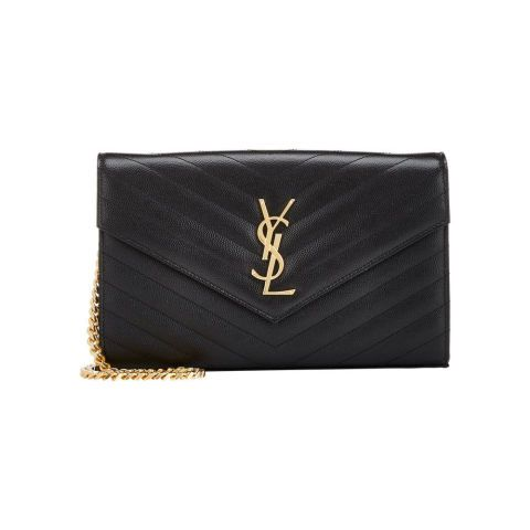 Saint Laurent's wallet on chain hits the sweet spot between a proper purse and your average clutch. Saint Laurent Black Monogram Chain Wallet; barneys.com
