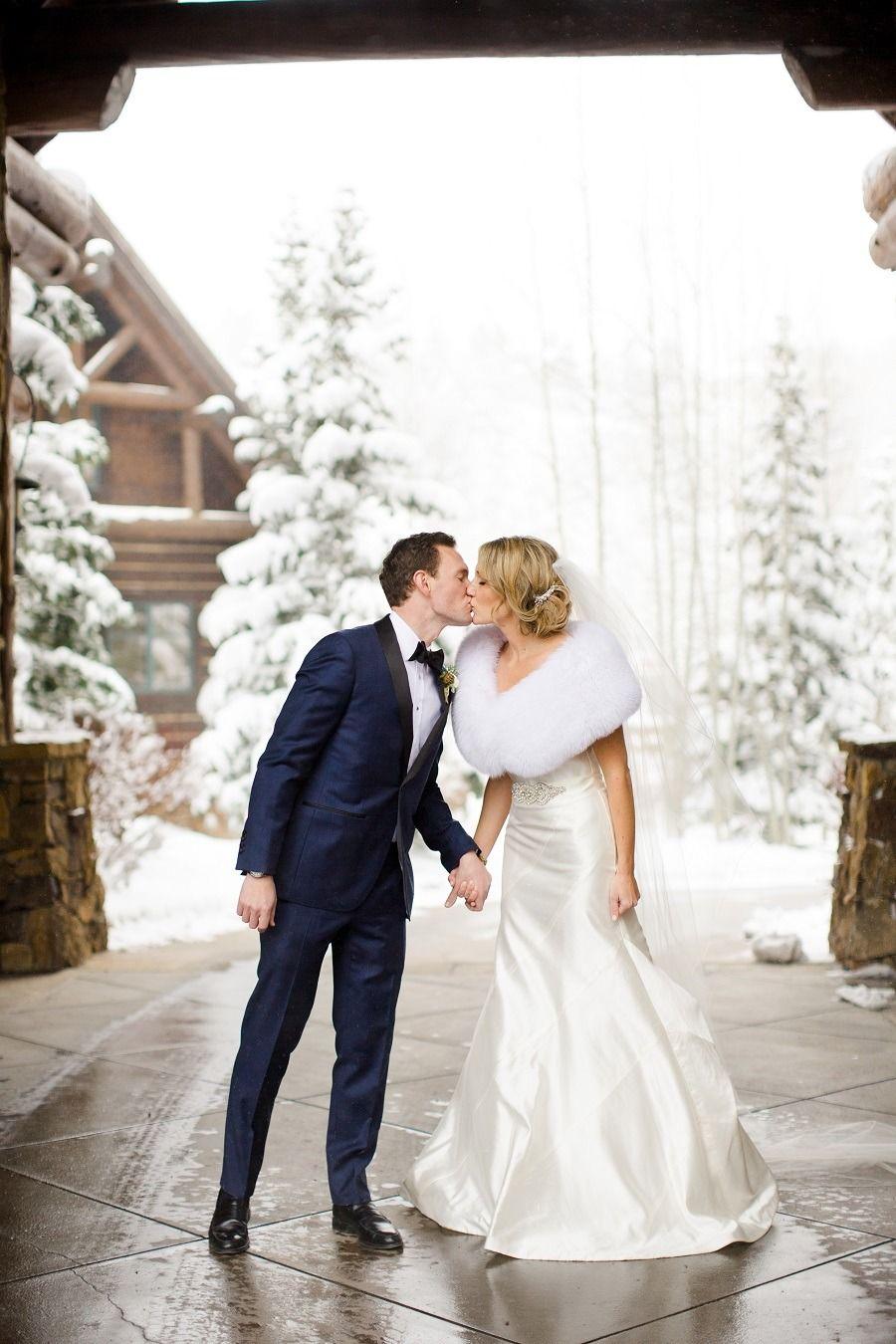 Winter Wedding Attire Navy Tuxedo For The Groom White Fur Stole Bride