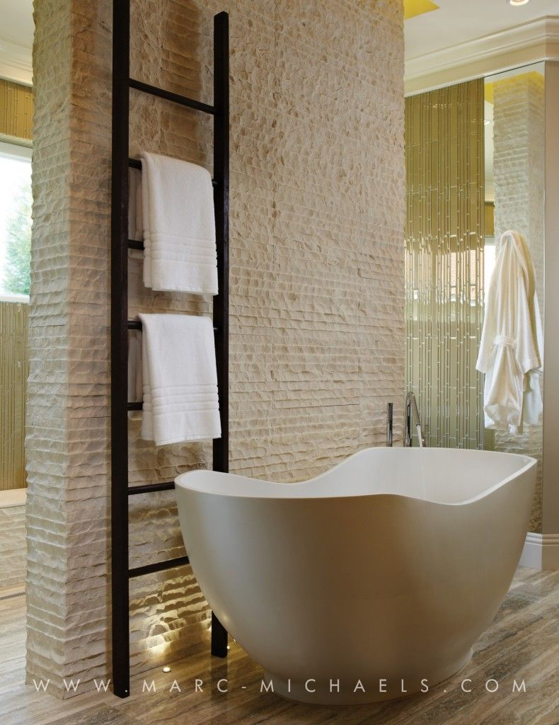 The master bathroom exudes a glamorous feeling through the free ...