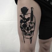 Photo of Black tattoo of a rose and dagger stabbed skull inked on the right thigh  Black …