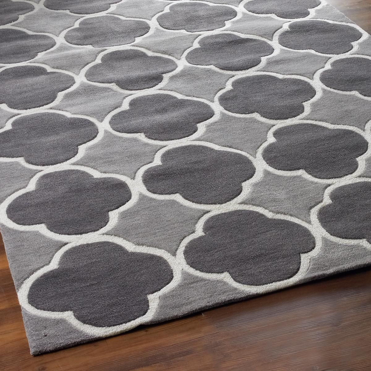 Cloverleaf Quatrefoil with Gray - 3 colors This classic quatrefoil pattern outlined in white loop pile is fresh and modern in popular gray color combinations. Crisp color contrast and simple geometry are woven in a plush cut and loop pile construction for dimension and durability. Select from Yellow with charcoal gray, Sea Blue with silver, or charcoal Gray with silver. 100% Poly/Acrylic pile can be spot cleaned with mild soap and water.