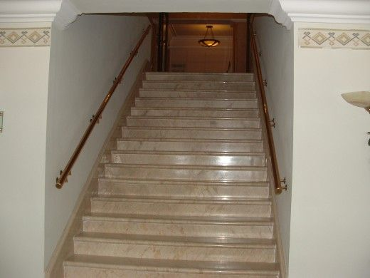 Indoor Marble Stairs View rustic railing at http://awoodrailing.com