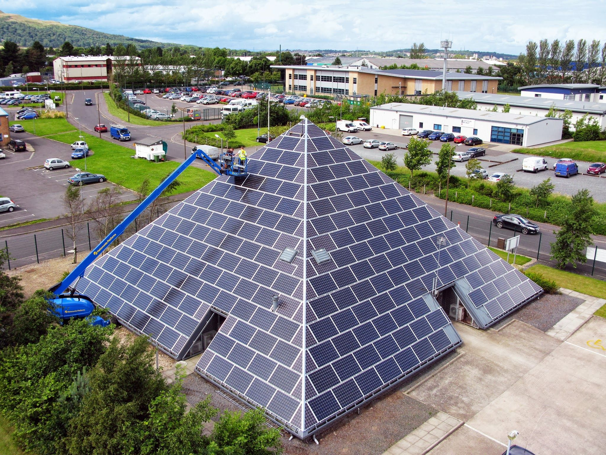 Office Building In England Covered In Solar Panels Fake Panels Used On Edges To Complete The Look Pyramid House Solar Pyramids