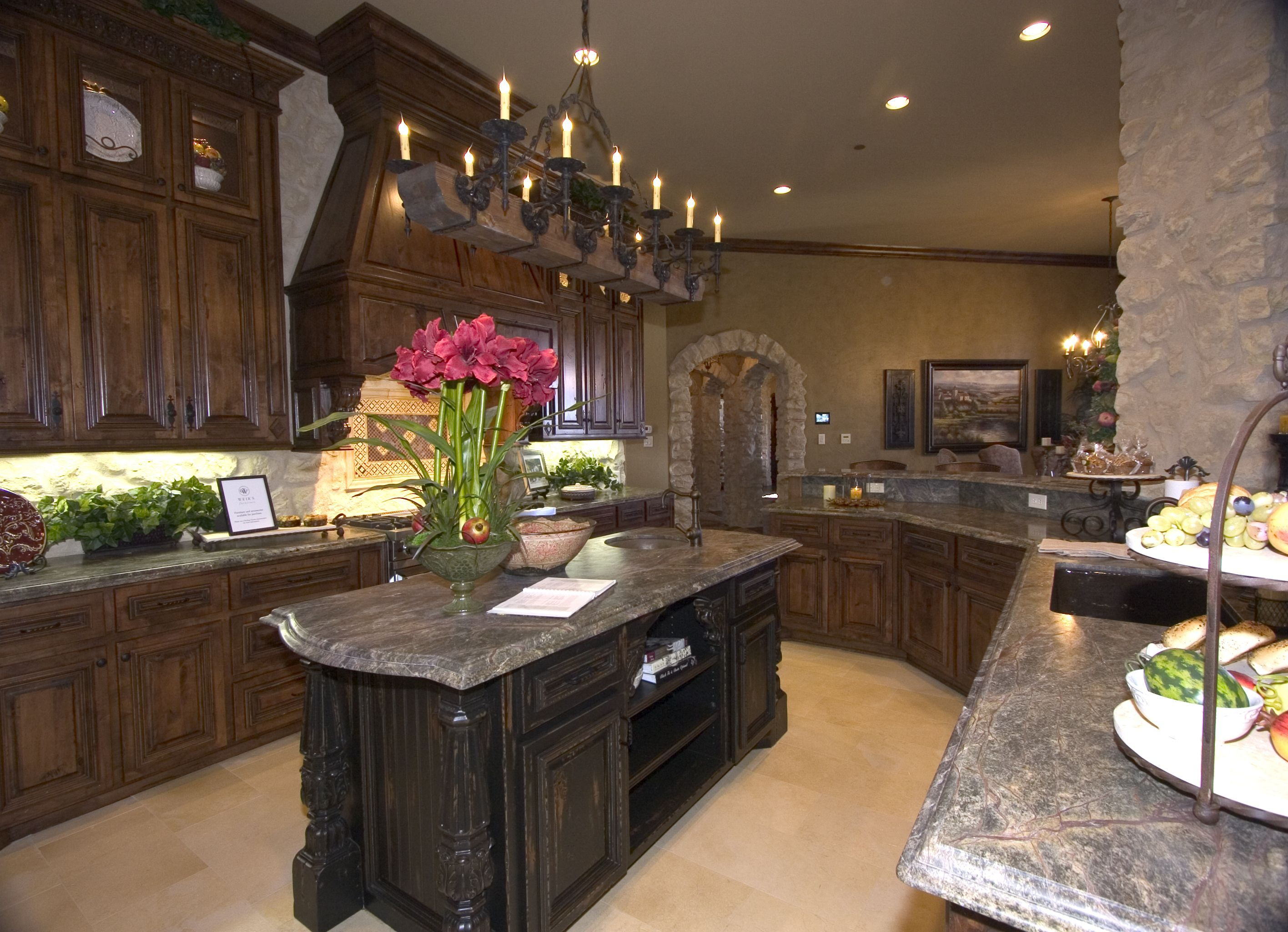 Kitchen With Distressed Knotty Alder Cabinets Limestone
