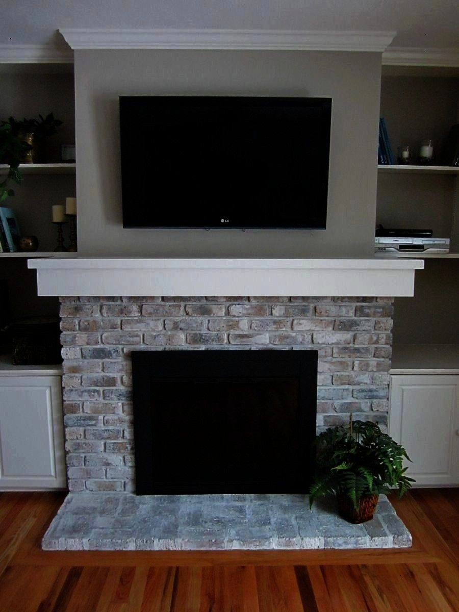 If your brick fireplace is in need of a face lift and removing the brick isnt a viable option for you whitewashing your existing brick is a great alternative This homeown...