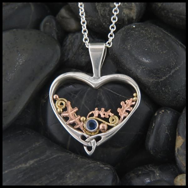 8d33b6f499531 Oak leaves and Spiral Celtic pendant in Sterling Silver and Gold set with a  blue Sapphire.