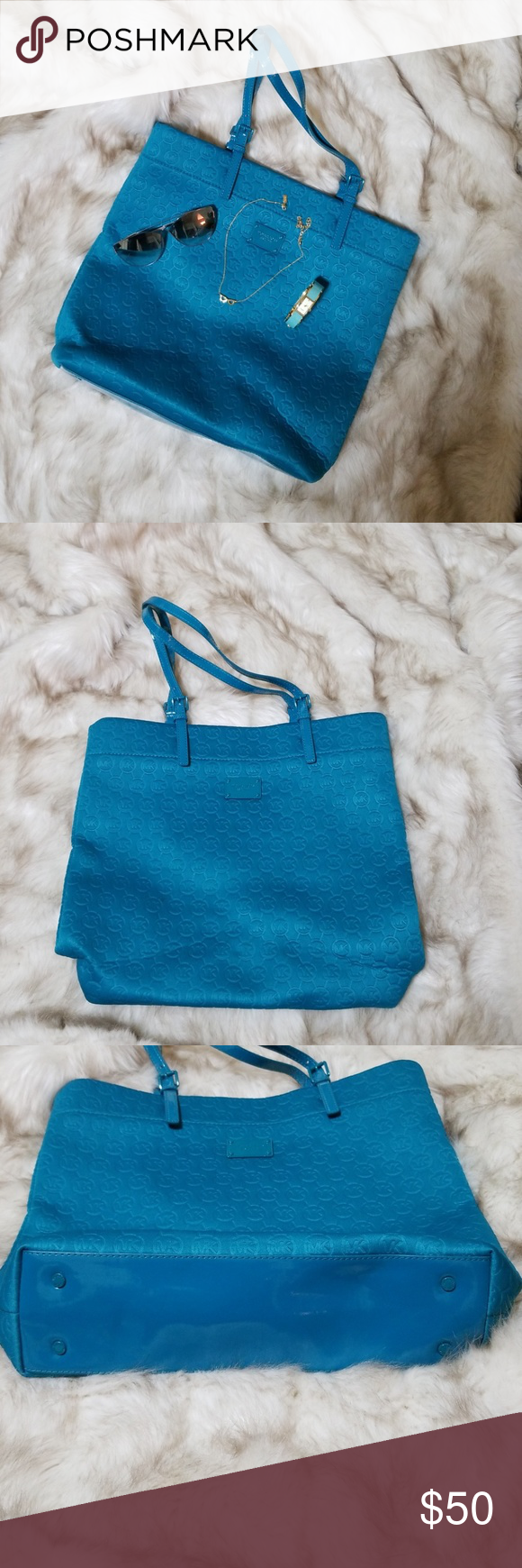 1be122463d8b Michael Kors Neoprene tote Teal neoprene tote, doubles as a great work or  school tote! Has a few pen marks on the lining... otherwise is great tote!!