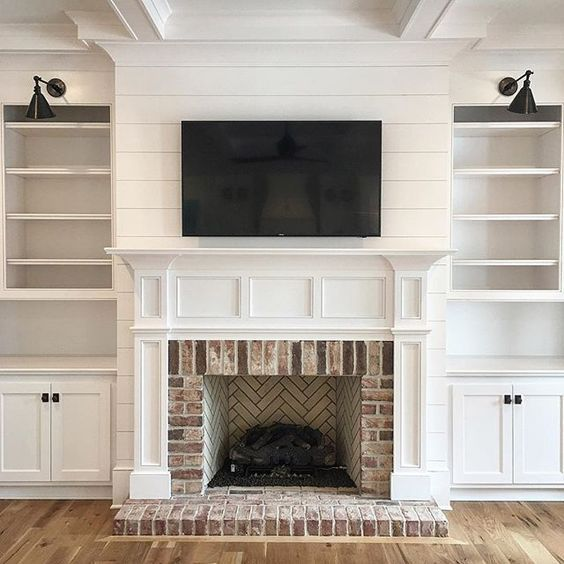 Beautiful Living Room Built In With Low Brick Hearth Ship Lap And Lights Over The Shelves