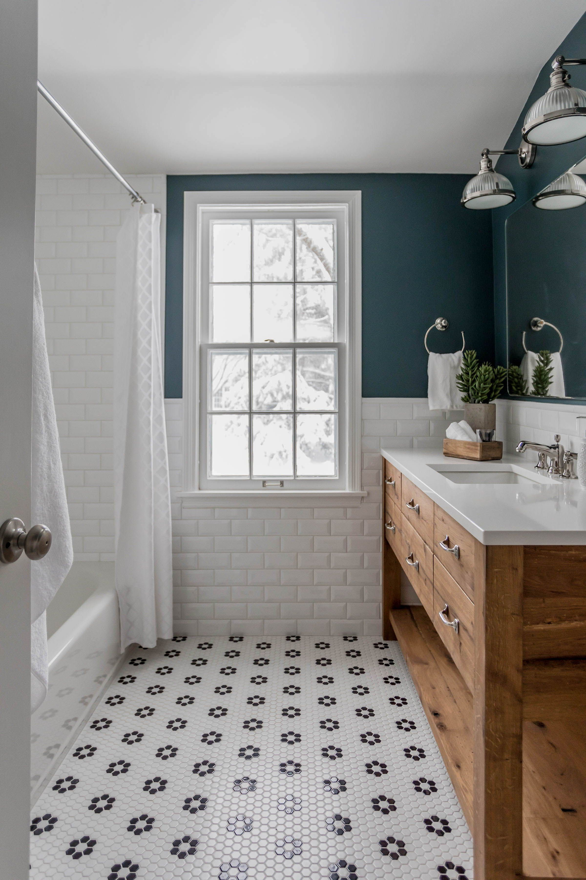 Reclaimed wood vanity, black and white tile, subway tile, dark green bathroom walls.