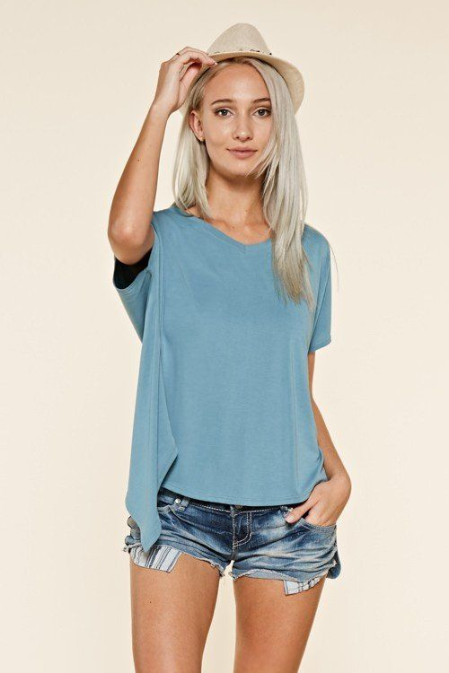 Comfortable top in the highly durable cupro fabric(a cousin of rayon.) Simple fold over back detail gives this top the perfect edge.