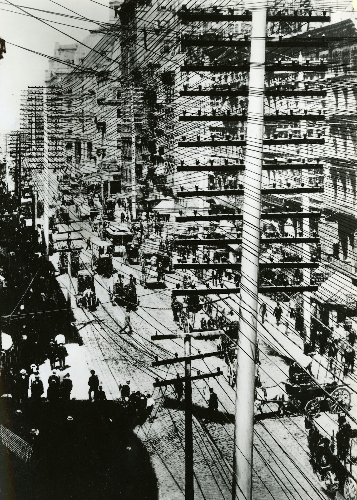 before most cables ran underground, all electrical, telephone and telegraph  wires were suspended from high poles, creating strange and crowded  streetscapes