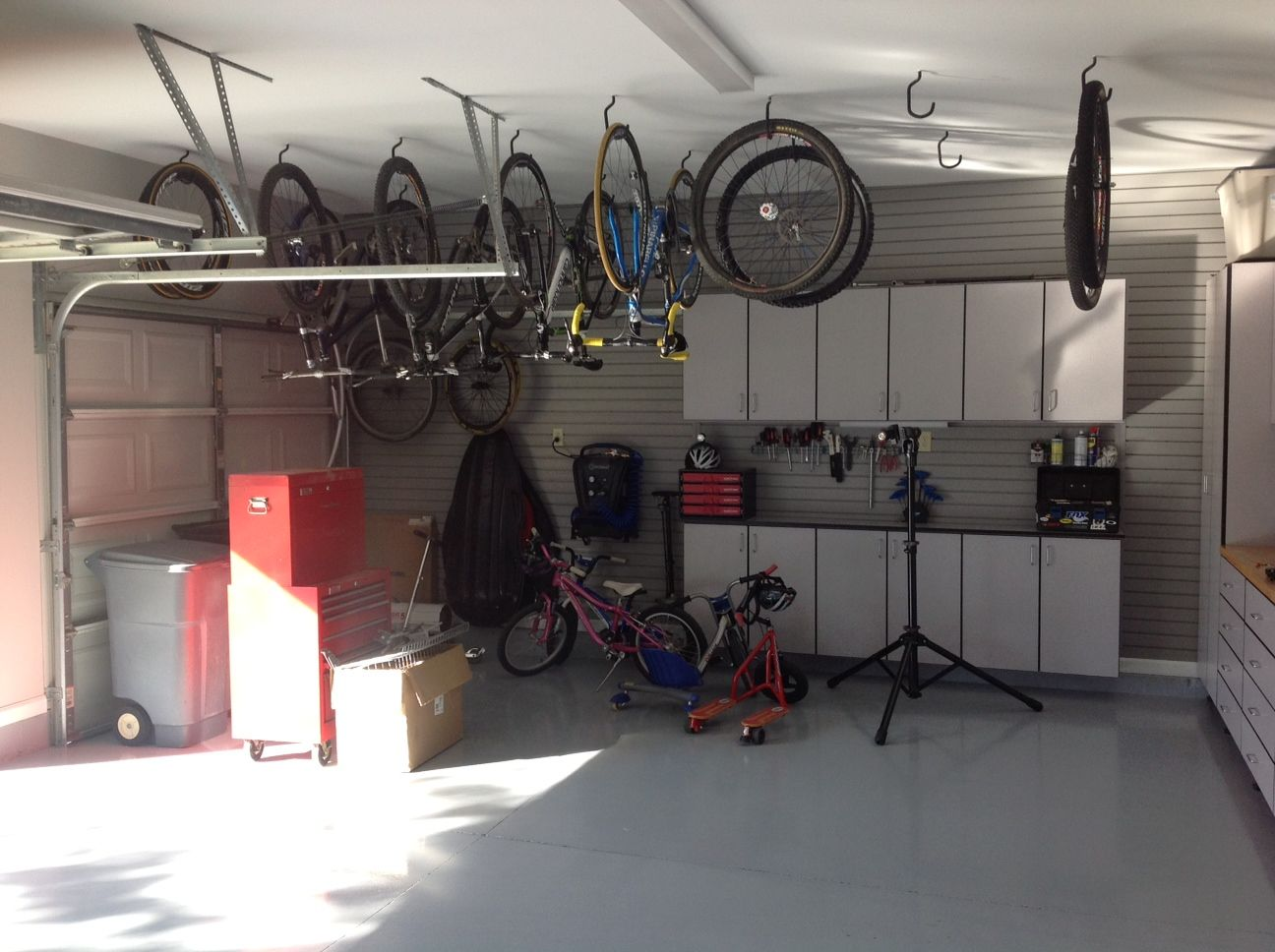 Example of hanging bikes in garage ceiling with hooks ...