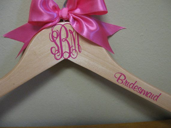 DIY. Buy stickers to monogram hangers. cute to have all of the bridesmaid dresses hanging up