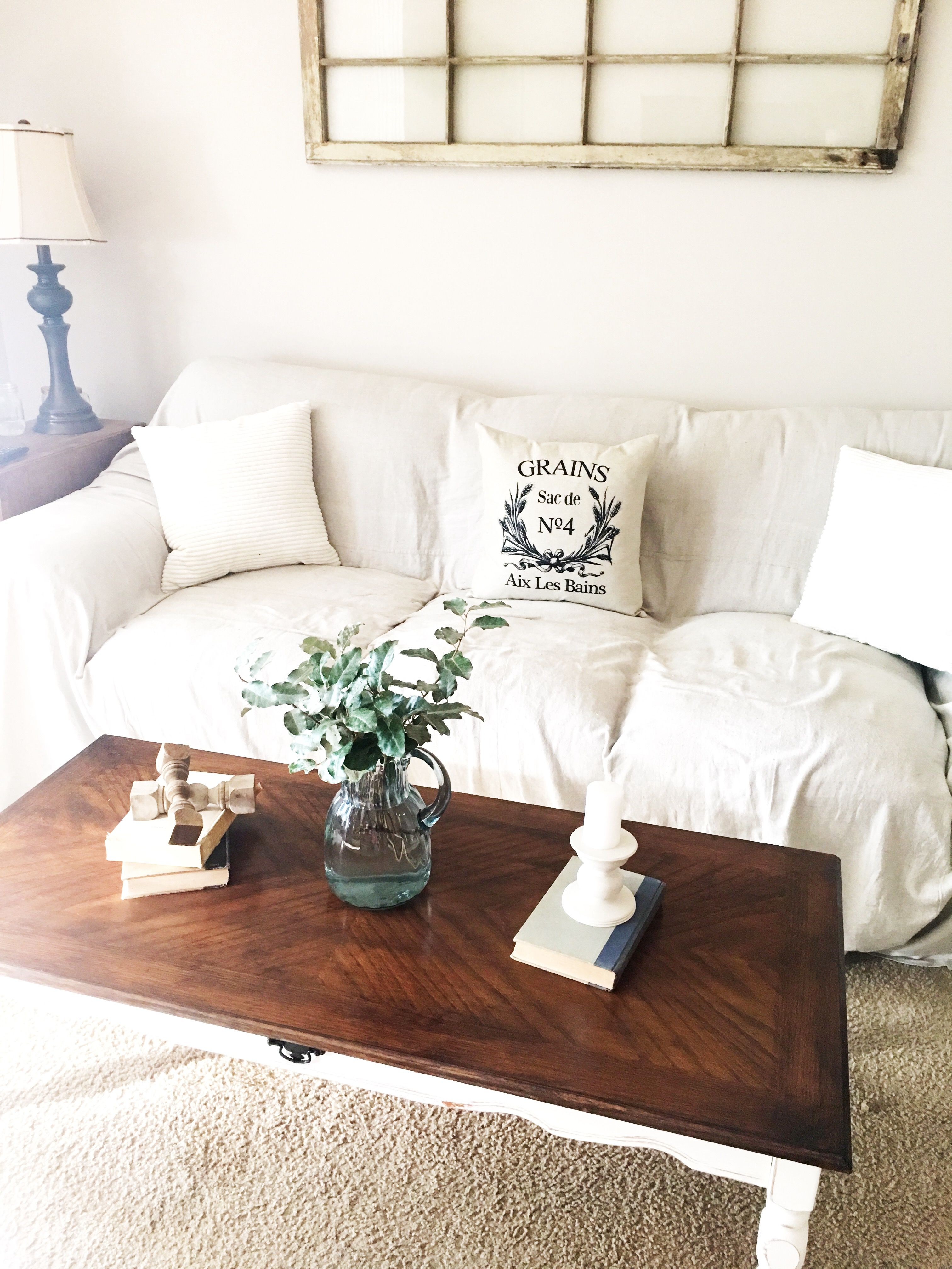 Farmhouse coffee table white couch cover living room