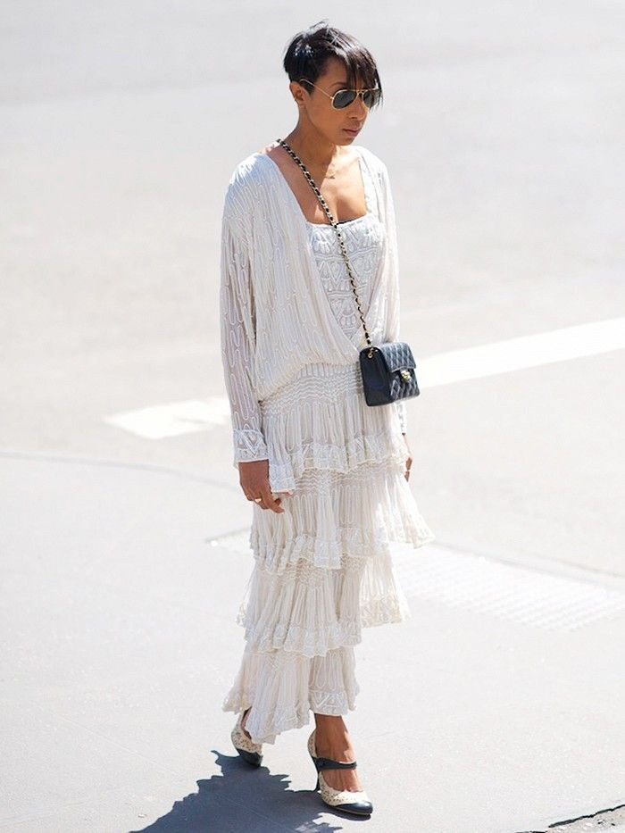 Karen Blanchard of Where Did U Get That in a lace dress and black mini crossbody bag