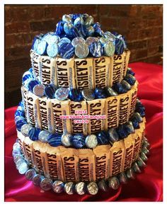 A 3 Tier Chocolate Candy Bar Cake Created With Hersheys Cookies And Cream Bars Ad Surrounded By Kisses This Is Sure To Make Delightful