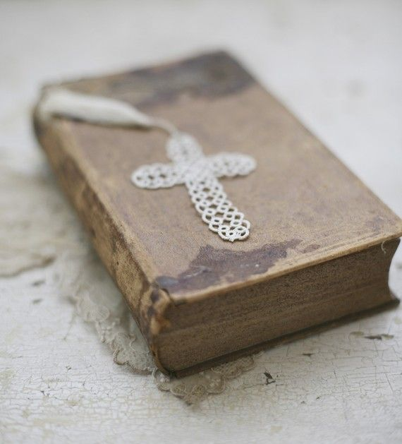 antique Bible with a sweet little lace cross