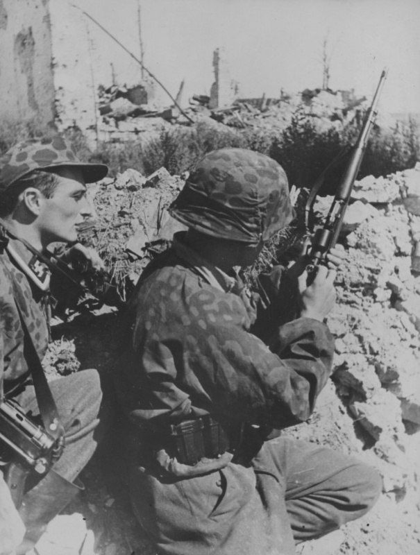 Waffen SS Sniper and NCO in the trenches on the front East.