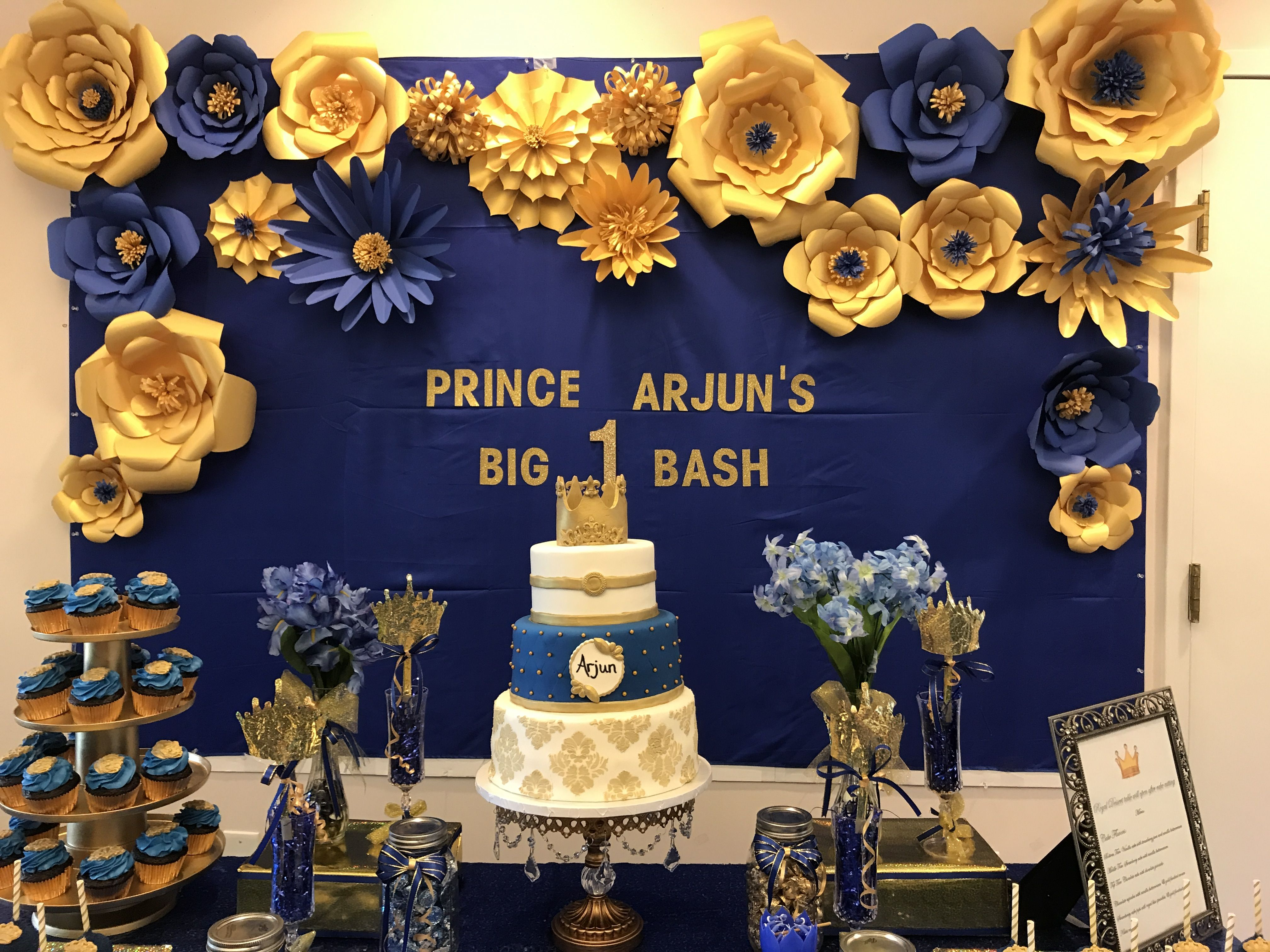 b01df40125f03 Paper flowers done with royal blue and gold cardstock. Goes well for a prince  theme birthday party or baby shower.