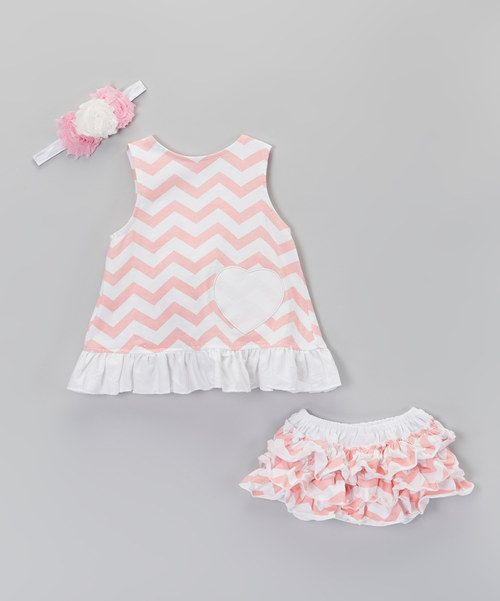 This set is swinging with style! Boasting a darling swing top with ruffled hem, some oh-so-comfy bloomers and a matching headband, these pieces will be pulled from the wardrobe time and time again.Includes top, bloomers and headbandHeadband: 12'' circumferenceHeadband embellishment: 4.5'' W x 2.5'' H97% polyester / 3% spandexSpot cleanImported