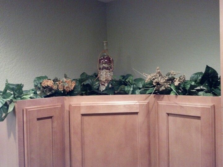 Above kitchen cabinets decorations diy...fill empty wine bottles ...