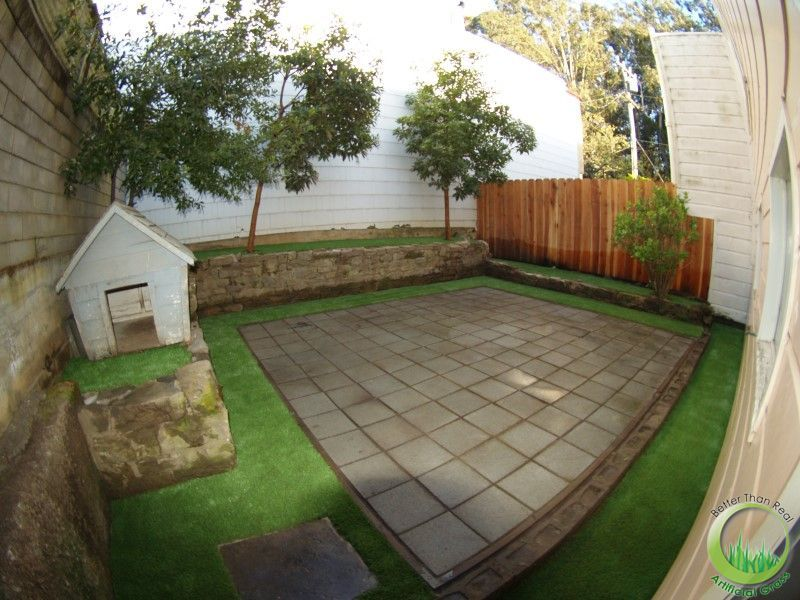 Small backyard just for the dog with artificial turf. I ...