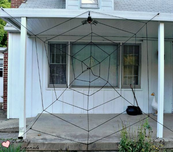 Want to be the talk of the neighborhood this Halloween? Learn how to - spider web halloween decoration