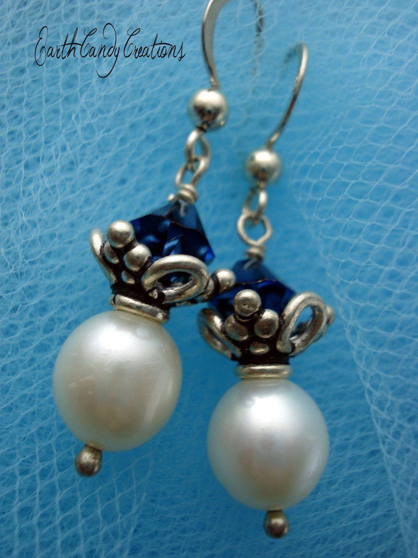 Earrings Bleu de France Deep Ocean Blue by EarthCandycreations. Flip the bead cap and it looks like a crown. Coolio.