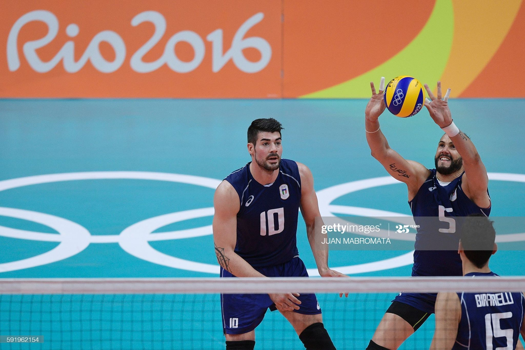 Italy S Osmany Juantorena Sets The Ball During The Men S Semi Final In 2020 Volleyball Images Rio Olympics 2016 2016 Olympic Games