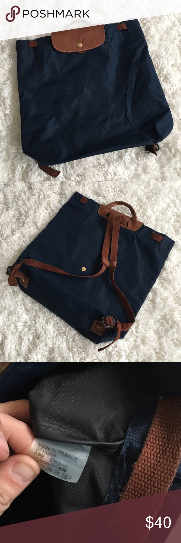38716b79aa0a Navy blue longchamp backpack Good used condition with minor flaws. Inside  liner has some spots