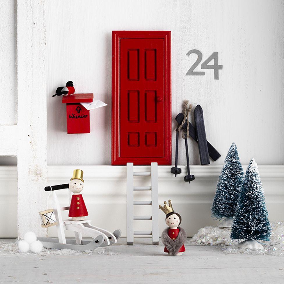 Santaland with elf doors christmas for Homemade elf door