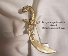 5 day only Sale 10% off storewide ends 4/22 Contact me 4 discount taken at invoice or refunded after purchase   Fabulous Dragon monkey with wings Sword Brooch