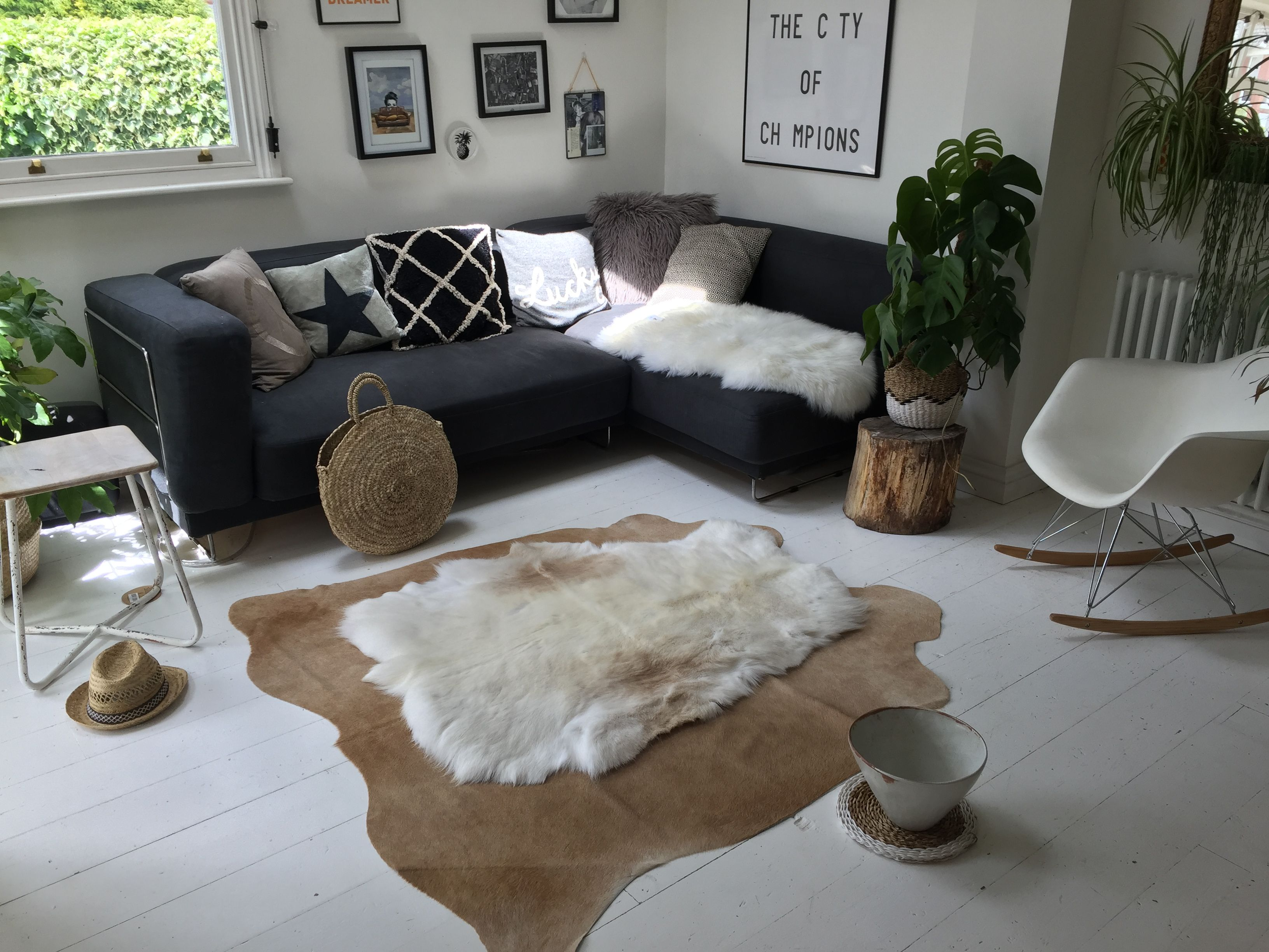 More Chaos A Natural Brown Cowhide Rug With A Pure White Nordic Reindeer Hide Rug Placed Down Reindeer Hides Reindeer Hide Rug Sheepskin Pillows
