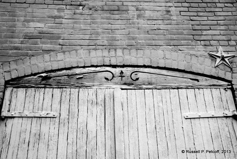 White door near South Washington Street in Old Town Alexandria, Virginia.