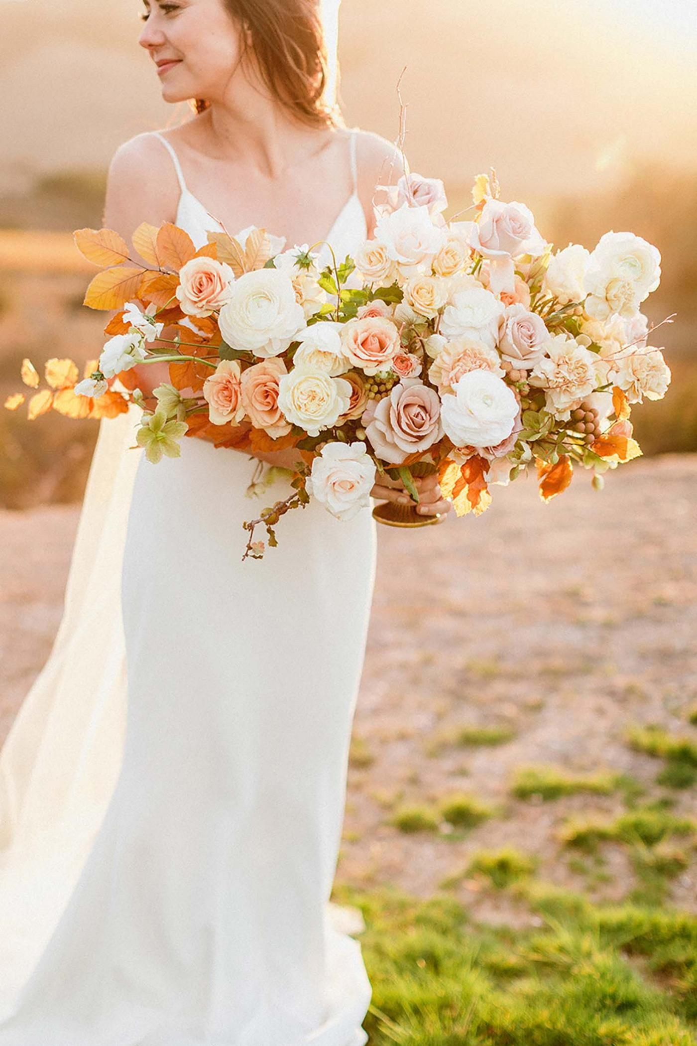 39854c2a24d8 this bridal bouquet contains a lot of roses in different colors like white,  blush and light apricot combined with some fall foliage, it makes the  perfect ...
