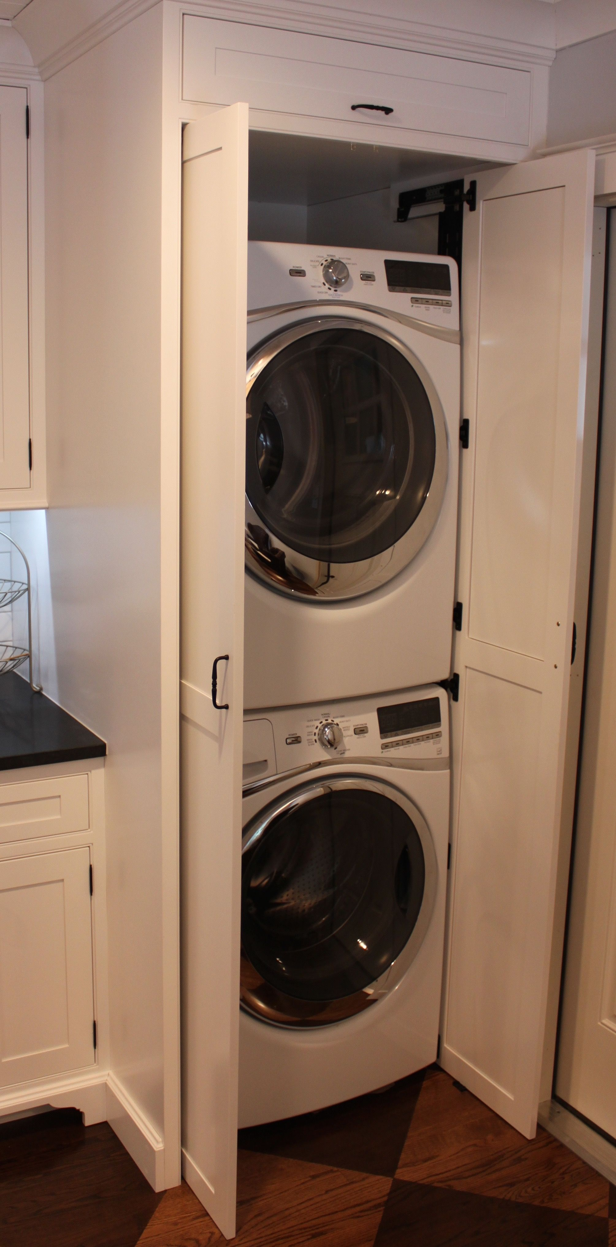 In Kitchen Laundry Cabinet With Pocket Doors Washer Dryer Laundry Room Laundry Room Laundry Room Organization