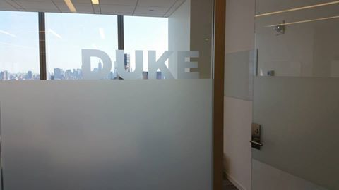 Custom Frosted Vinyl Letters Applied To Glass Paneling Sitting On Band In NYC We