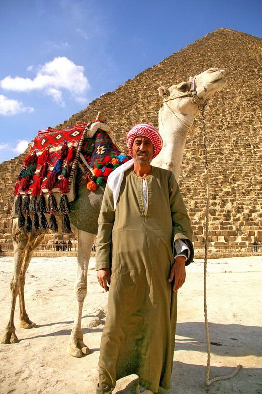92c4cdcf08ea Egyptian bedouin in front of Pyramides.. -