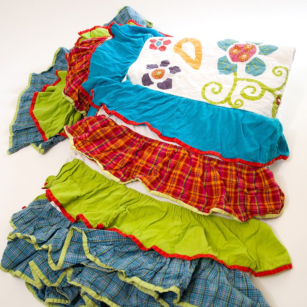 Pier 1 for Kids twin bedspread with lots of ruffles..I don't even have a twin bed but had to snag it. It may turn into a dress one day.