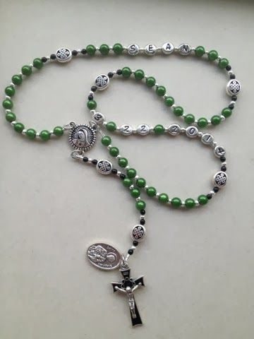 Through The Grapevine Baptism Personalized Keepsake Rosary. Dark green miracle beads for the Aves, Celtic knot ovals for the Paters, Our Lady of Guadalupe centerpiece, Crown of Thorns black inlaid crucifix, St. Stephen medal. https://www.etsy.com/shop/throughthegrapevine