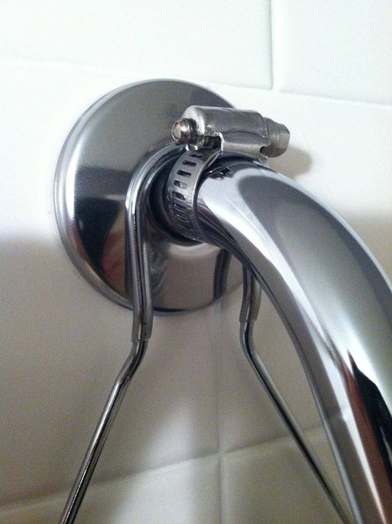 Use A Hose Clamp To Keep A Shower Caddy From Sliding Off With