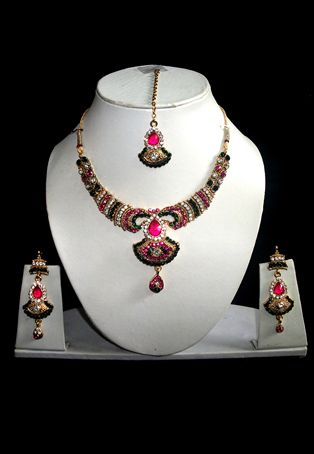 Complete charm of your outfit with this pink and green stone studded alloy based adjustable necklace set. The length of the earring is 2.5 inches. It comes along with a matching mangtika. data-pin-do=