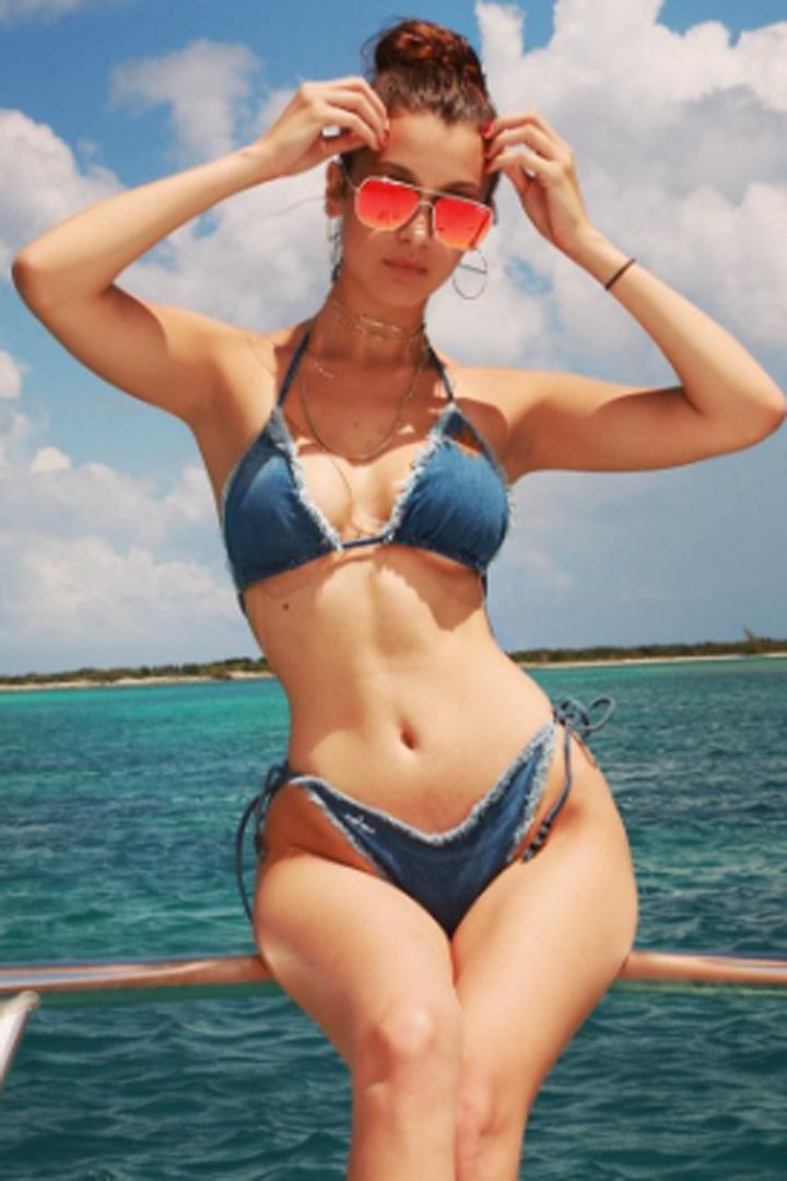 0cc45e32bd Bella Hadid s Instagram account is overflowing with scorching-hot swimsuit  pictures.