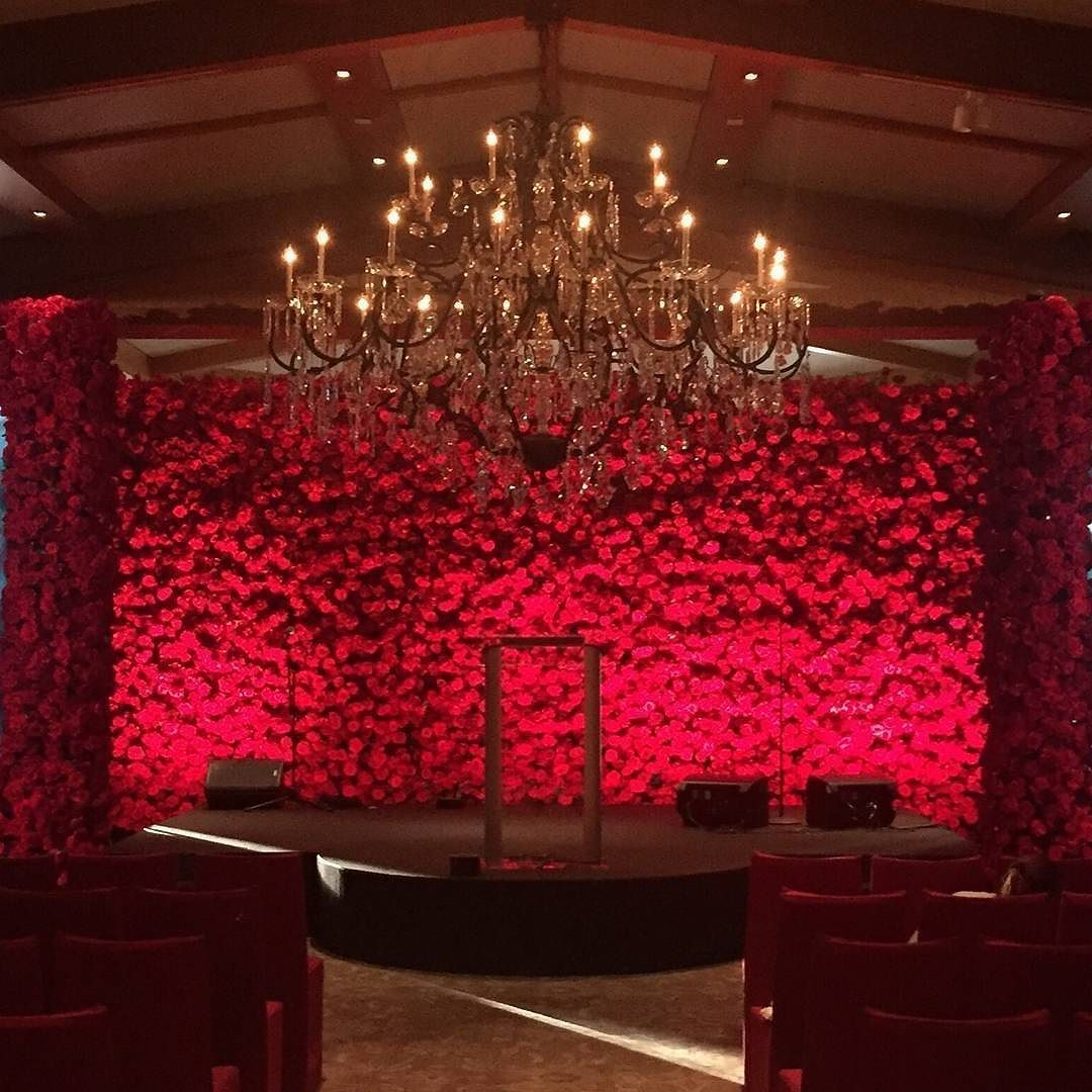 A Stunning Backdrop Of Red Roses By Marksgarden Red Wedding Decorations Wedding Stage Decorations Red Rose Wedding