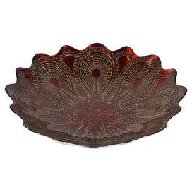 """Glass plate in red with a golden medallion motif.   Product: PlateConstruction Material: GlassColor: Red and goldDimensions: 2.25"""" H x 13"""" Diameter"""